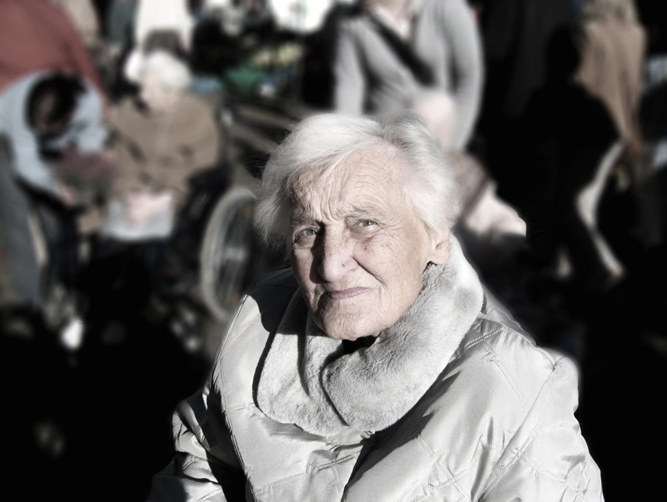 Elderly woman looking into camera
